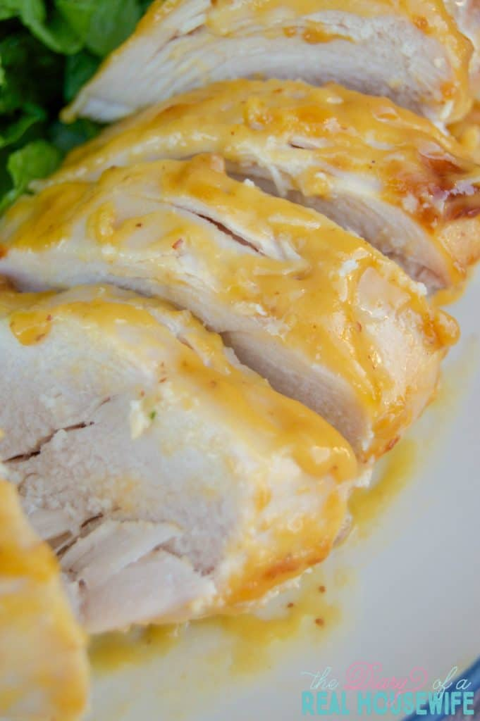 Honey Mustard chicken close-up on plate with salad