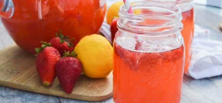 This simple Strawberry Lemonade is the perfect summer drink and is made with two simple ingredients. It's perfect for summer days and what we will be making all season long.
