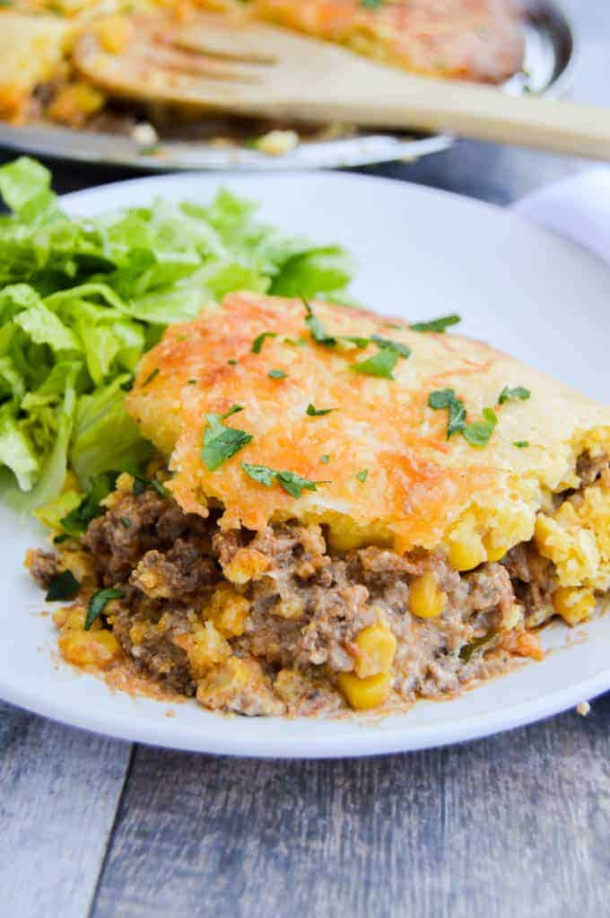 Easy Cornbread Taco Pie on a white plate with salad