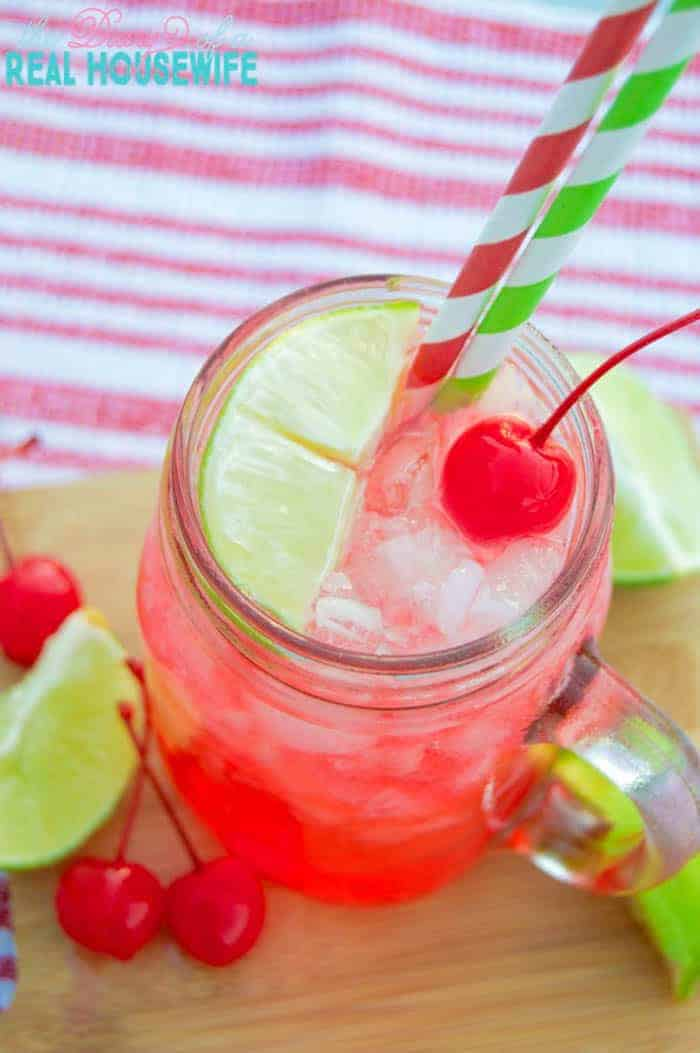 Cherry Limeade closeup with lime slice and cherries
