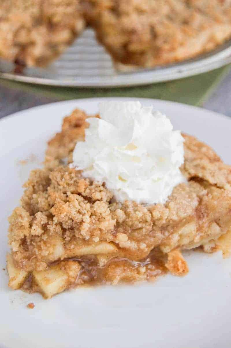 dutch apple pie on a white plate