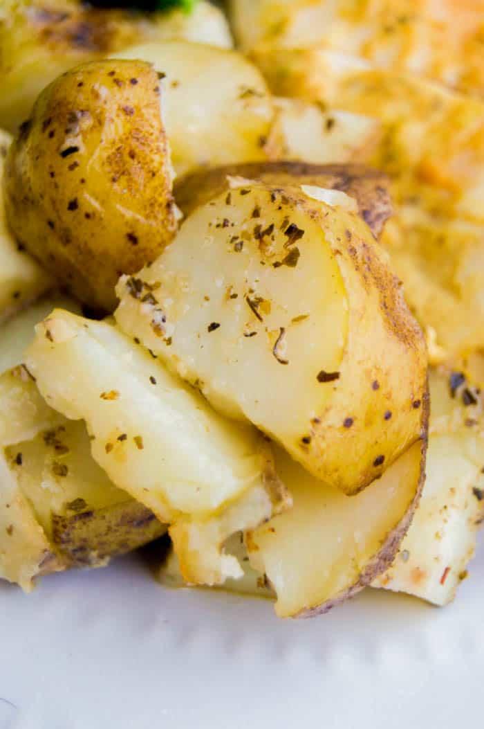 closeup of Italian potatoes on white plate