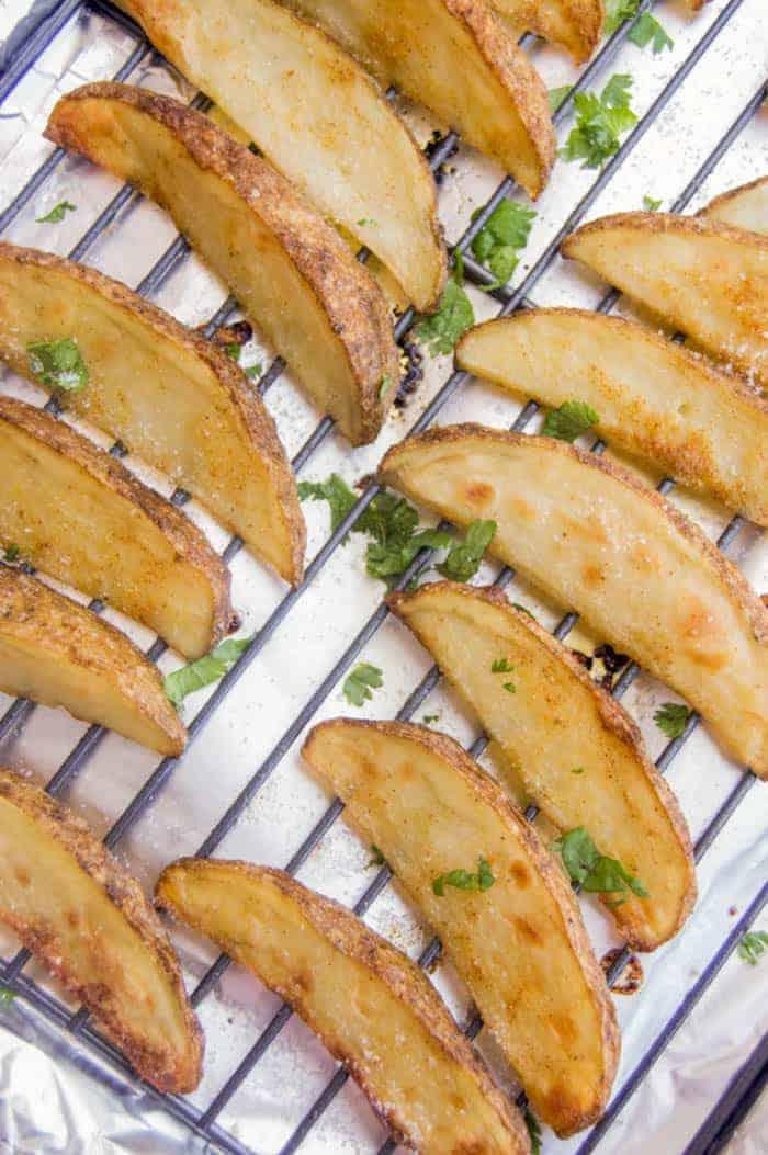 Crispy Potato Wedges on a baking sheet