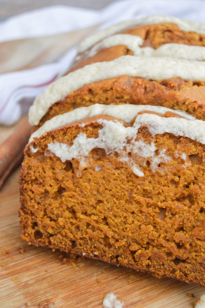 Pumpkin Bread with Maple Icing on a wooden board