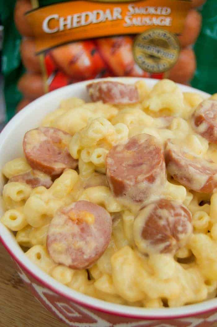 Slow Cooker Mac and Cheese with Cheddar Smoked Sausage in a red bowl