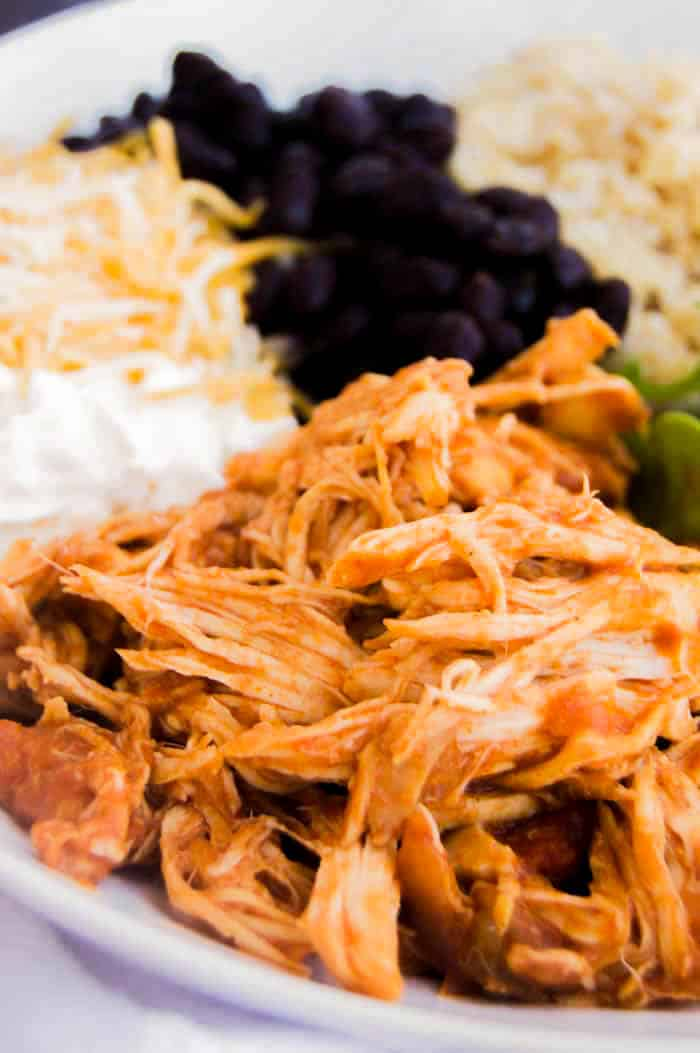 Slow Cooker Shredded Mexican Chicken in a bowl with other ingredients