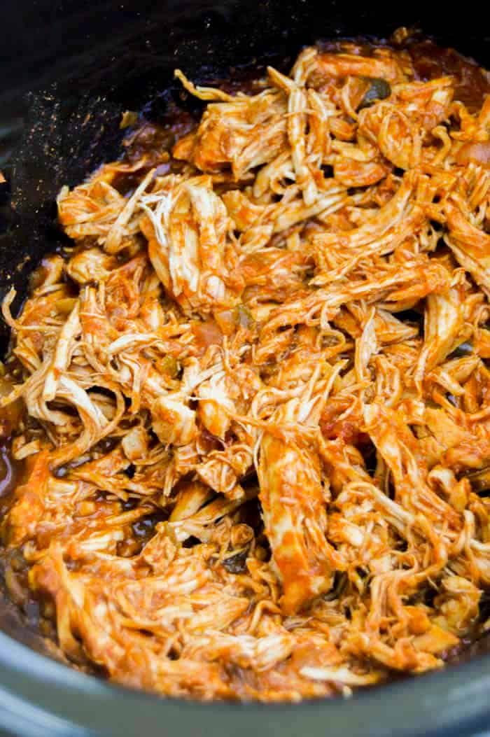 Slow Cooker Shredded Mexican Chicken in a black slow cooker