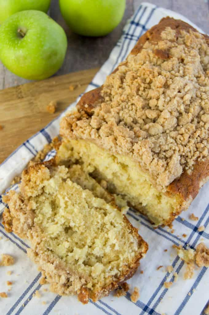 Dutch Apple Pie Bread sliced on a cutting board
