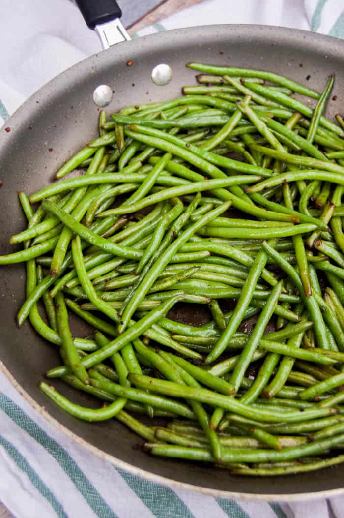 Skillet Green Beans in skillet on white and green cloth