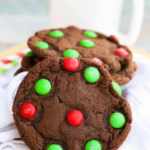 Chocolate M&M Christmas Cookie on a napkin with milk