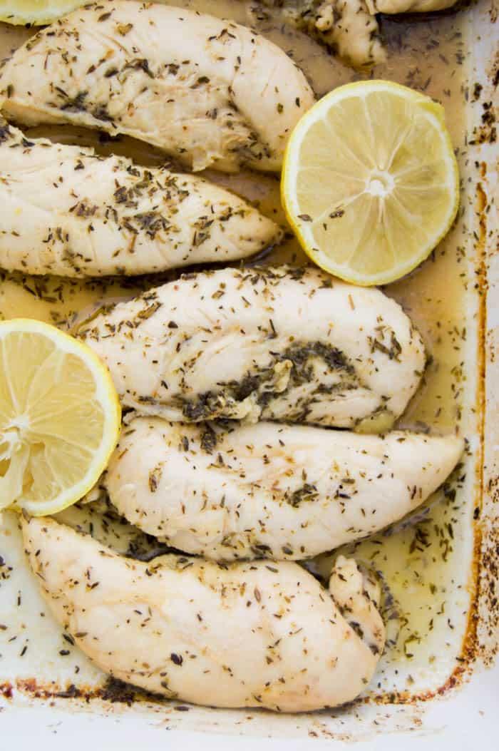 Lemon Garlic Chicken Tenders baked and garnished with fresh lemons