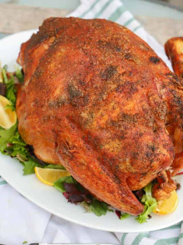 Full baked turkey on plate with dressings
