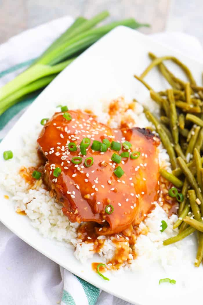teriyaki chicken on bed of rice with green beans