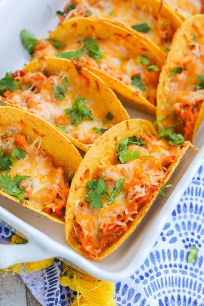 Baked Chicken Tacos in a white casserole dish