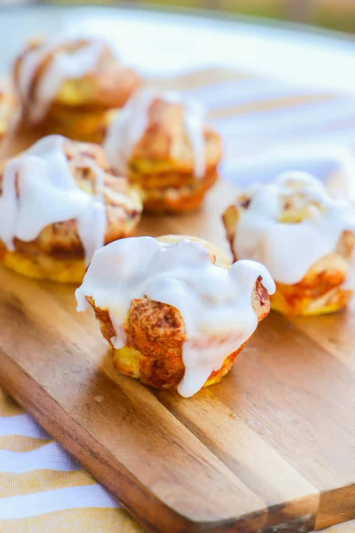 Cinnamon Roll Muffins on a wooden board