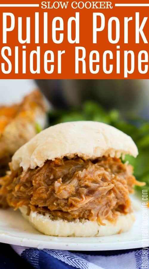 Slow Cooker Pulled Pork Sliders on a plate with salad