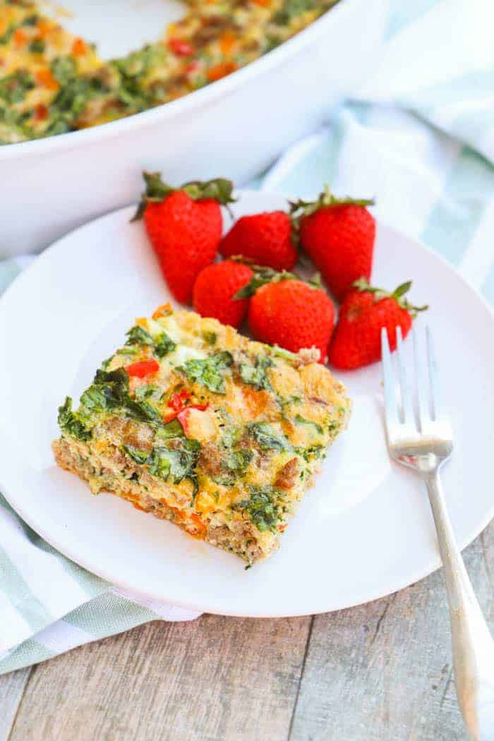 Make Ahead Low Carb Breakfast Casserole on a plate with strawberries