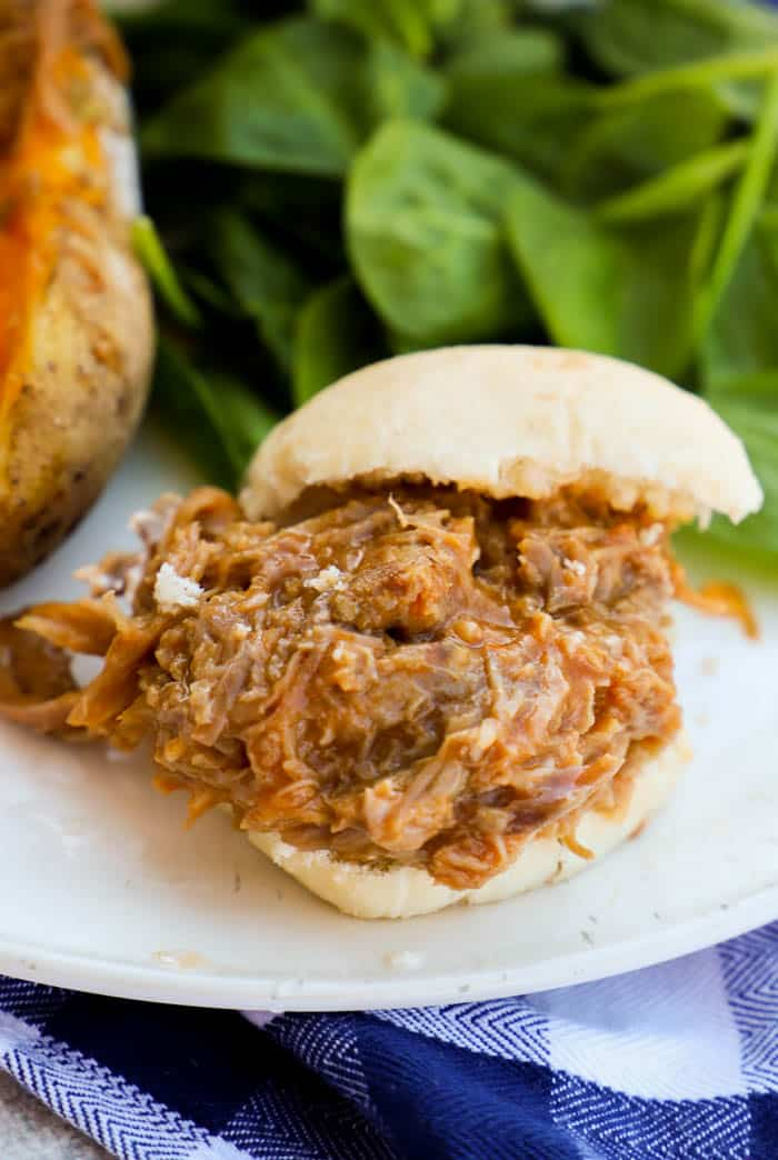 Close up Slow Cooker Pulled Pork Sliders on a white bun