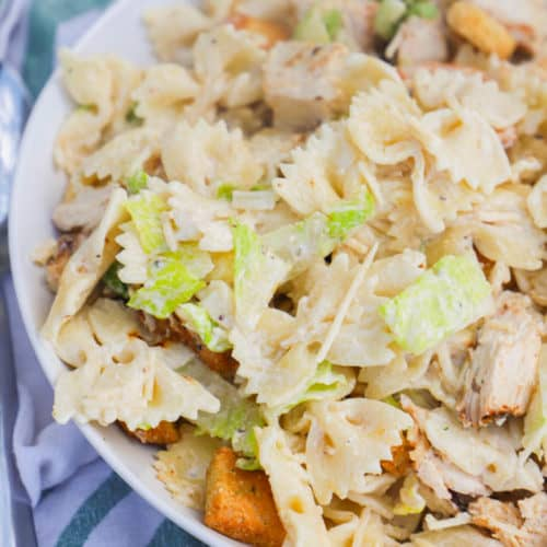 Chicken Caesar Pasta Salad in a white serving bowl