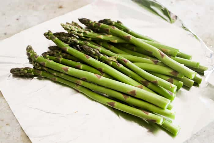 Grilled Asparagus laying on foil