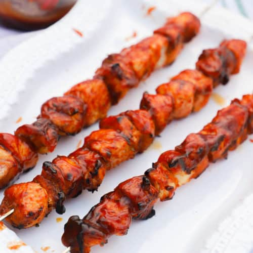 Grilled BBQ Chicken Kabobs on a white plate