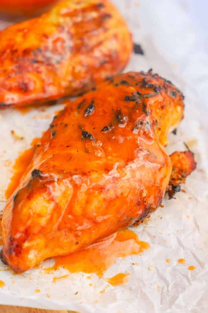 Up close photo of Grilled Buffalo Chicken on a cutting board