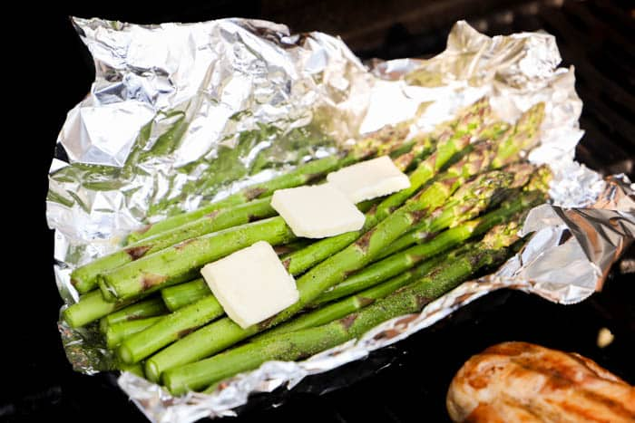 Grilled Asparagus on the grill with flames