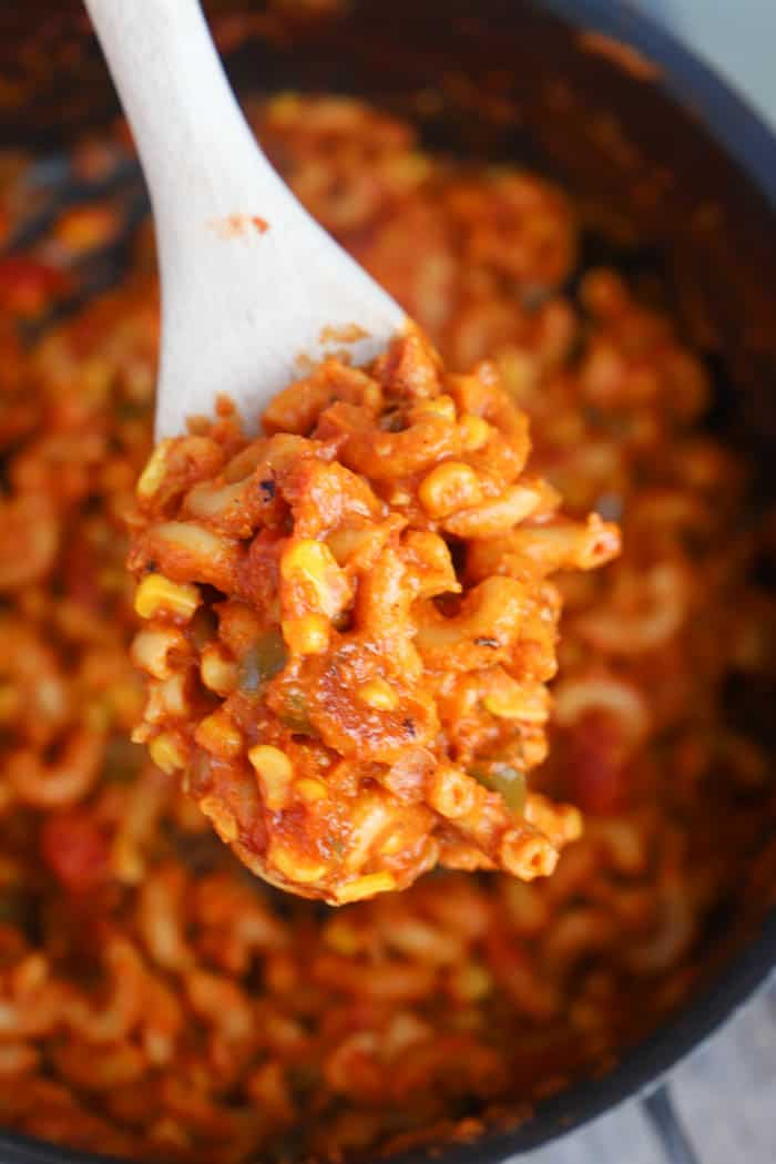One Pot American Goulash in a wooden spoon