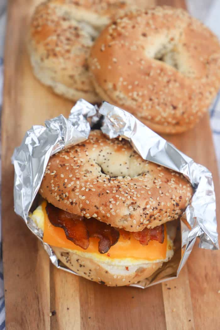 Freezer Bagel Breakfast Sandwiches in a Woden board with other bagels