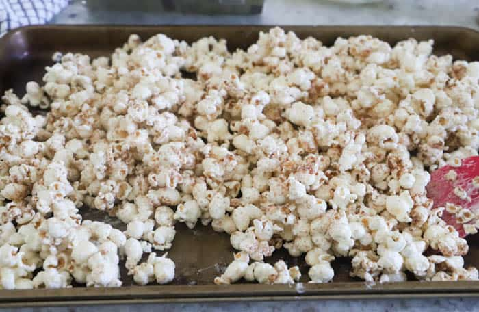 Pumpkin Spice Popcorn on a baking sheet