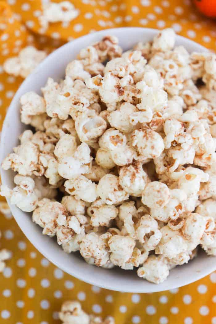 Pumpkin Spice Popcorn with a orange napkin