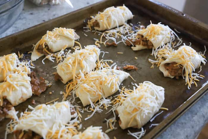 Taco Roll-Ups topped with cheese