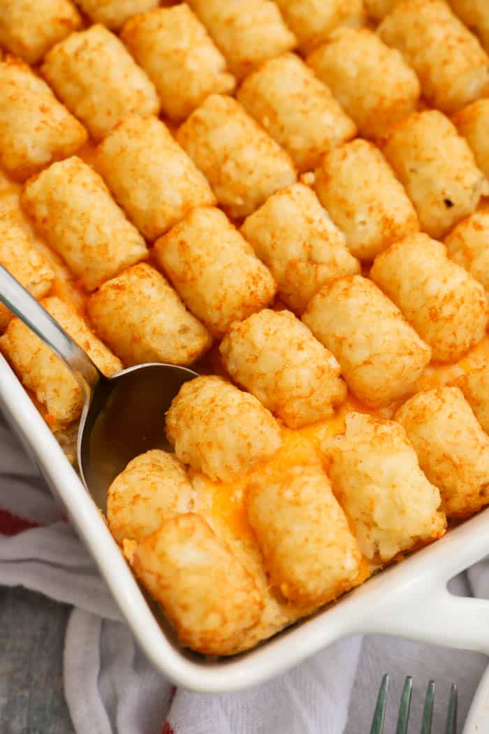 Buffalo Chicken Tater Tot Casserole scoping with a spoon