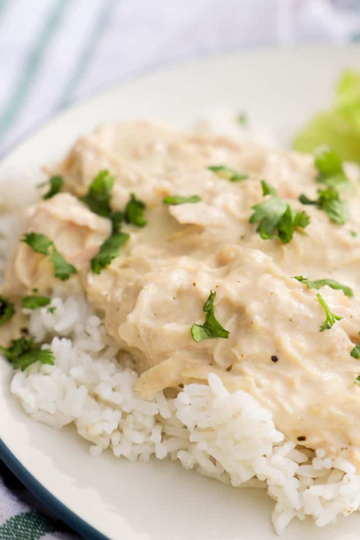 Slow Cooker Ranch Chicken on top of white rice