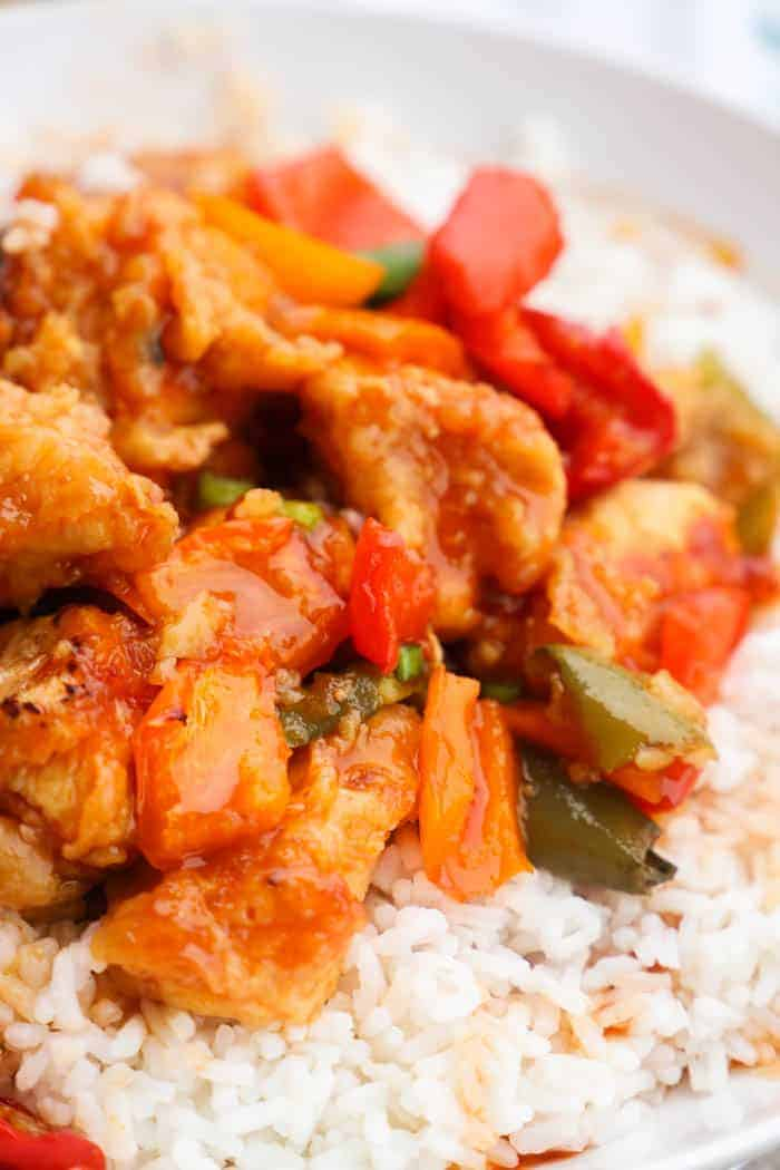 Sweet and Sour Chicken in a white dish with rice