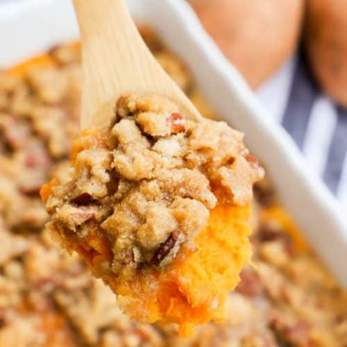 Sweet Potato Casserole in a wooden spoon