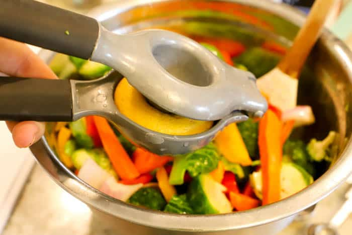 adding lemon juice to the Roasted Vegetables