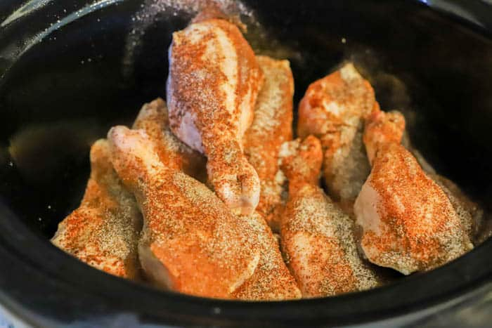 seasoned Slow Cooker BBQ Chicken Legs in the slow cooker