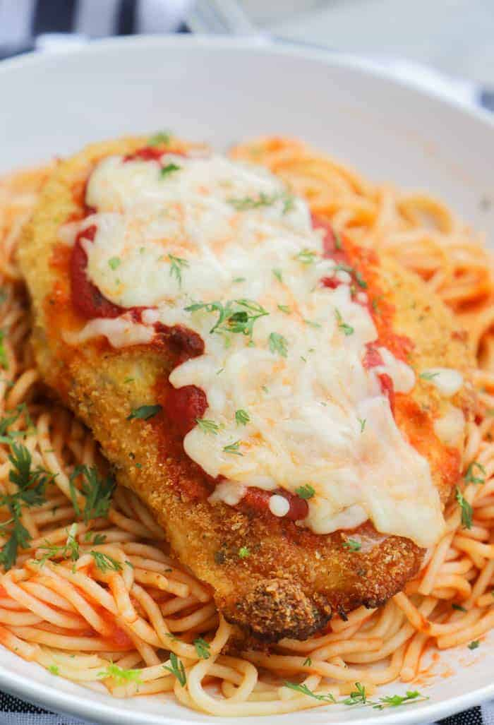 Baked Chicken Parmesan ready for dinner in a white plate