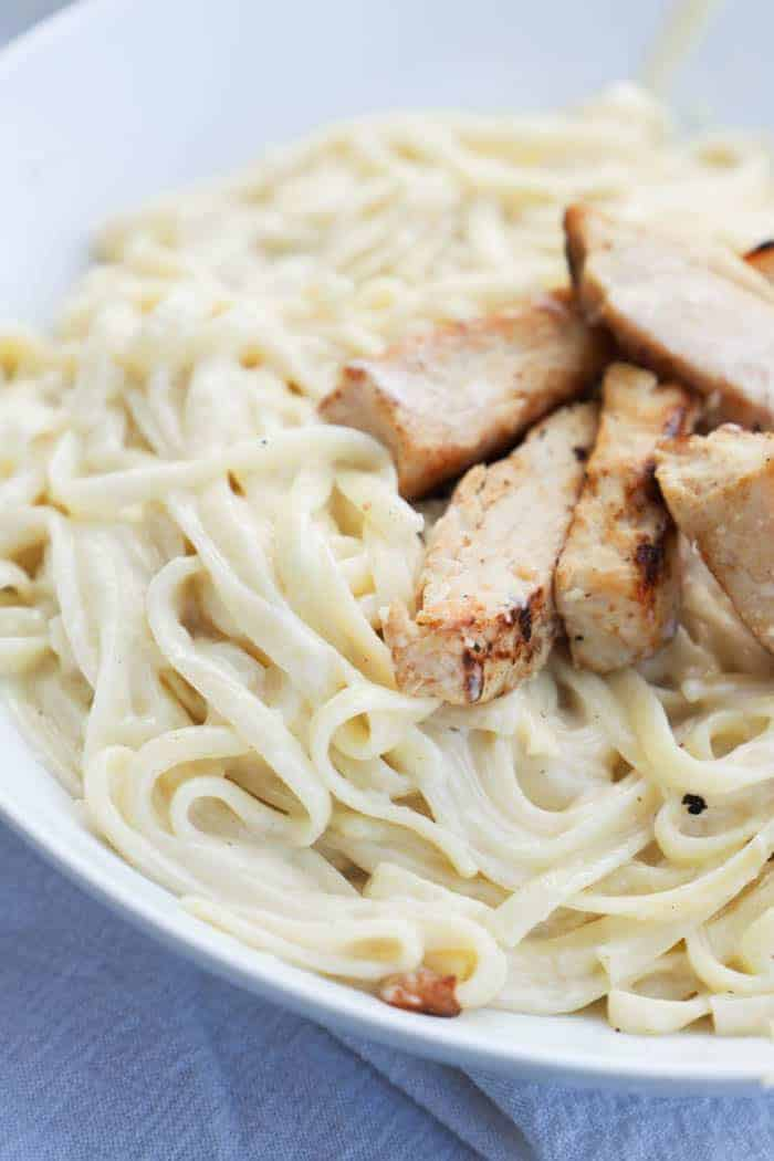 Homemade Alfredo Sauce in a bowl with chicken