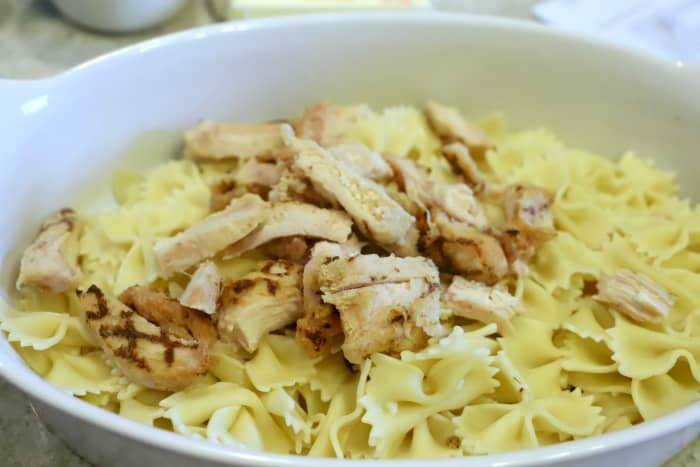 cooked pasta and chicken and placing into the casserole dish