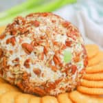 Classic Cheese Ball on a plate with crackers