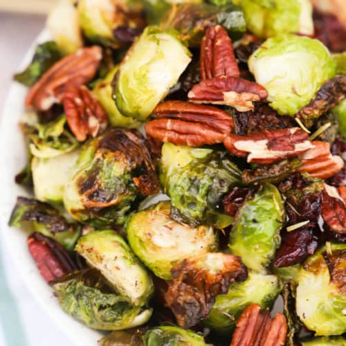 Cranberry Pecan Roasted Brussel Sprouts in a white bowl