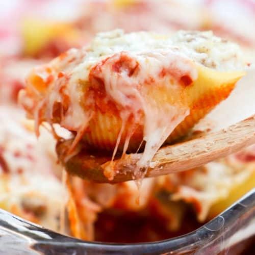 Lasagna Stuffed Shells on a wooden spoon