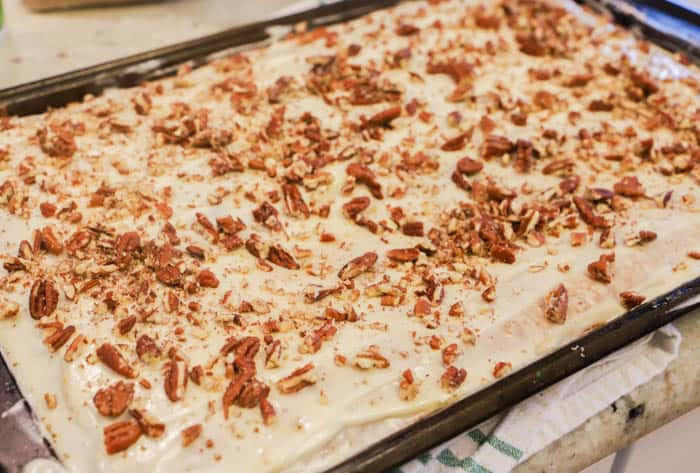Pumpkin Sheet Cake topped with frosting and pecans