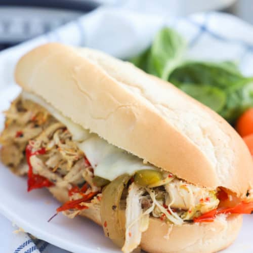 Slow Cooker Philly Chicken Cheesesteak on a plate with salad