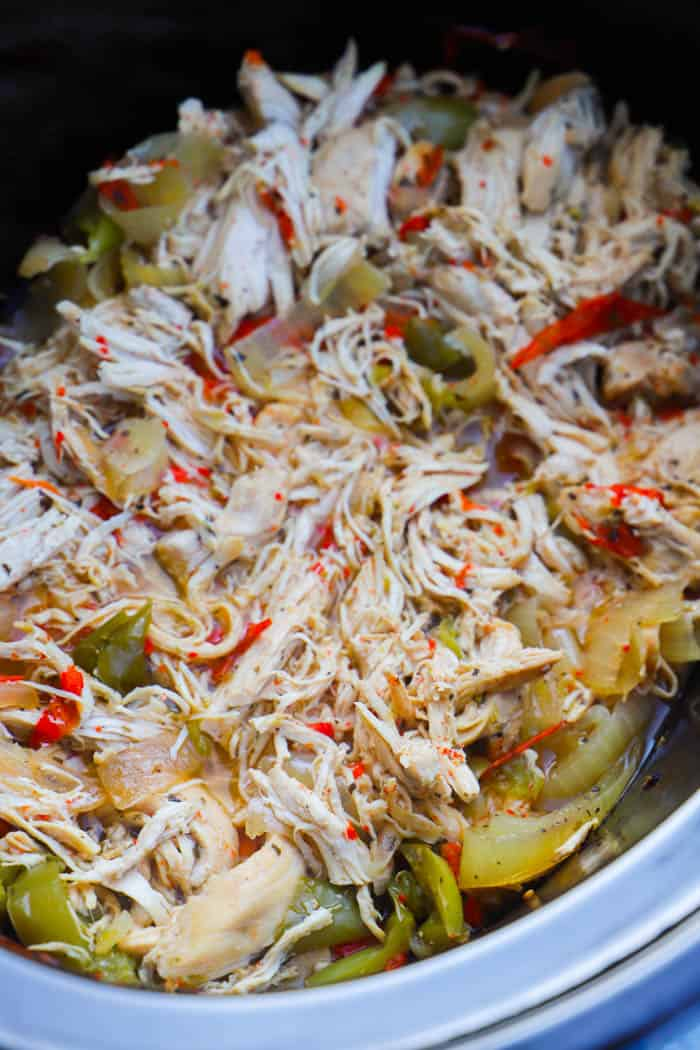Slow Cooker Philly Chicken Cheesesteak shredded in the slow cooker