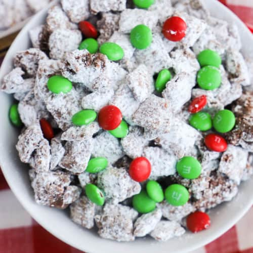Christmas Puppy Chow in a bowl on a red napkin