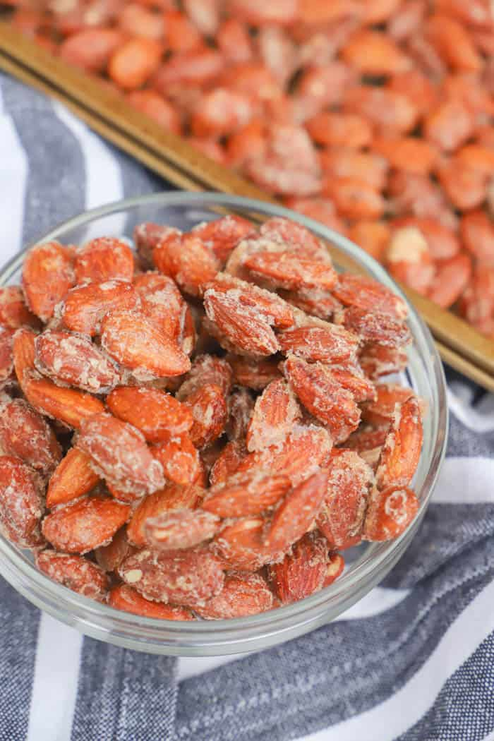 Cinnamon Roasted Almonds in a clear bowl