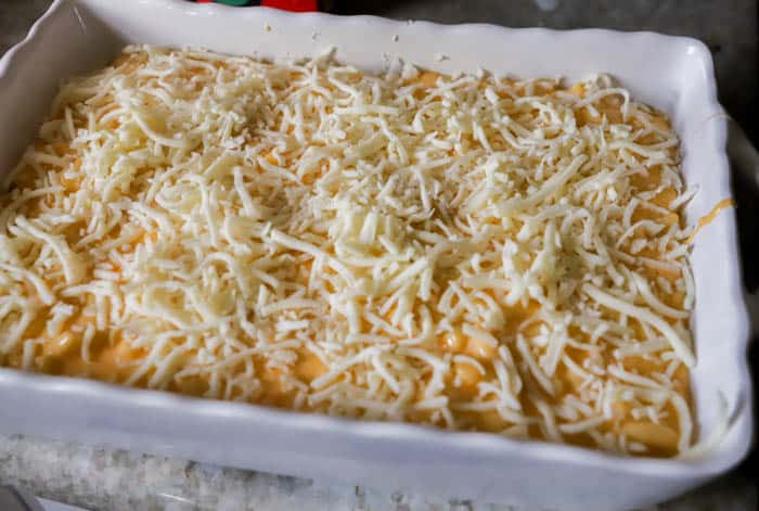 Creamy Mac and Cheese Casserole topped with shredded mozzarella